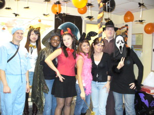 ILI students dressed up for Halloween in a decorated classroom