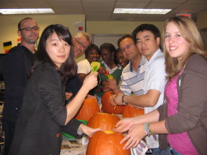 ILI students carving pumpkins