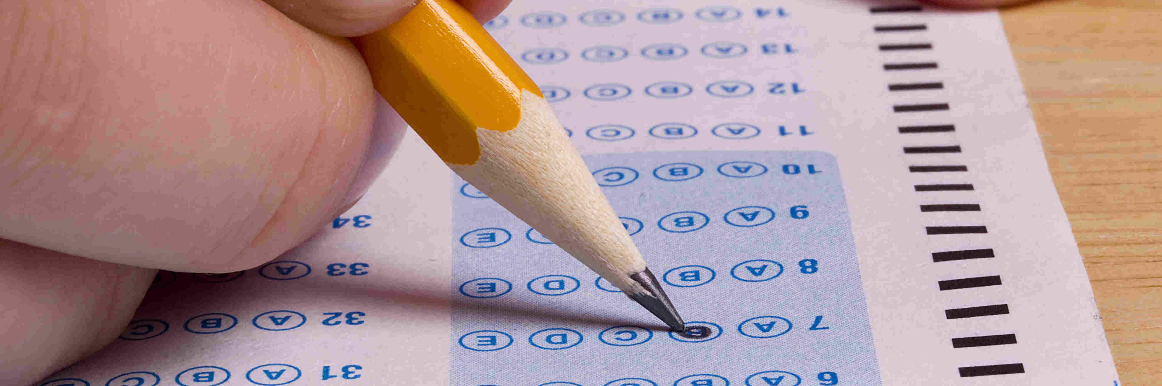 hand completing a multiple choice exam